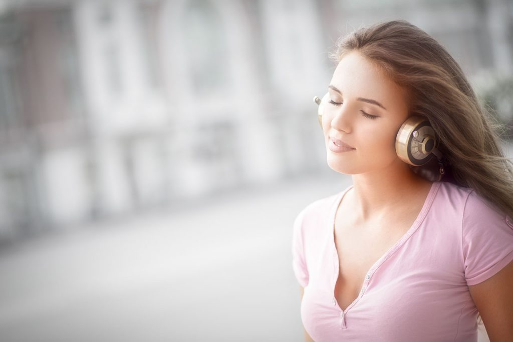 Girl listening to 8D Music with headphones