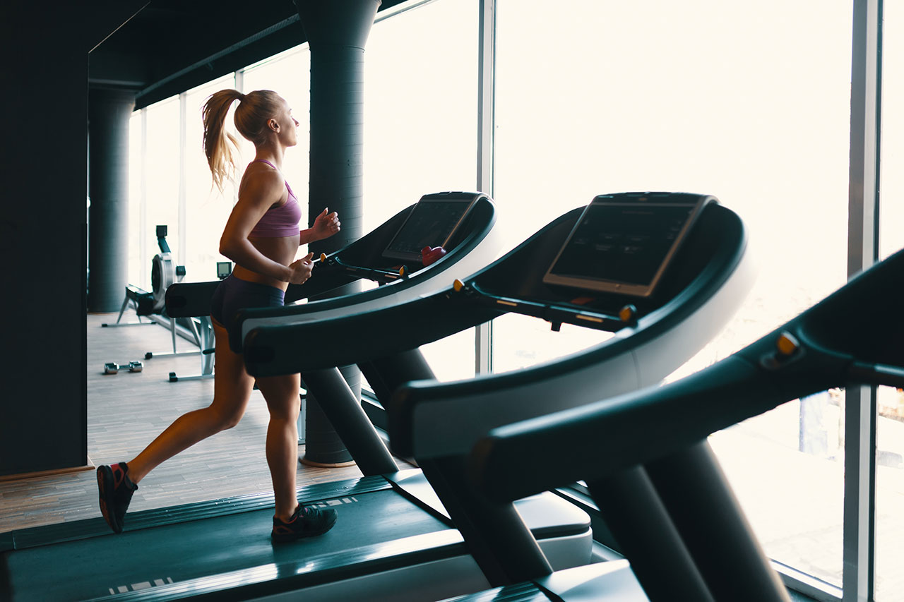 Blonde Woman Running on Treadmill