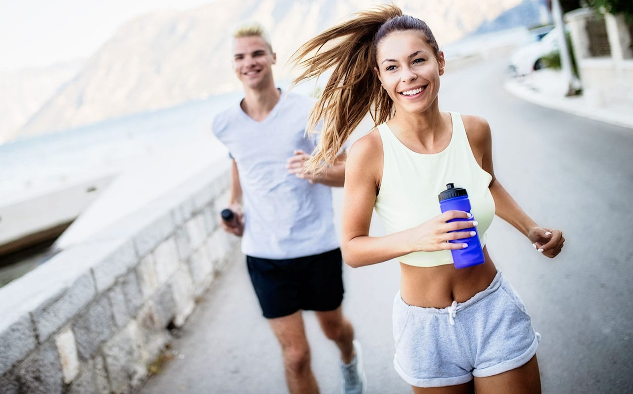 Couple Running in Summer